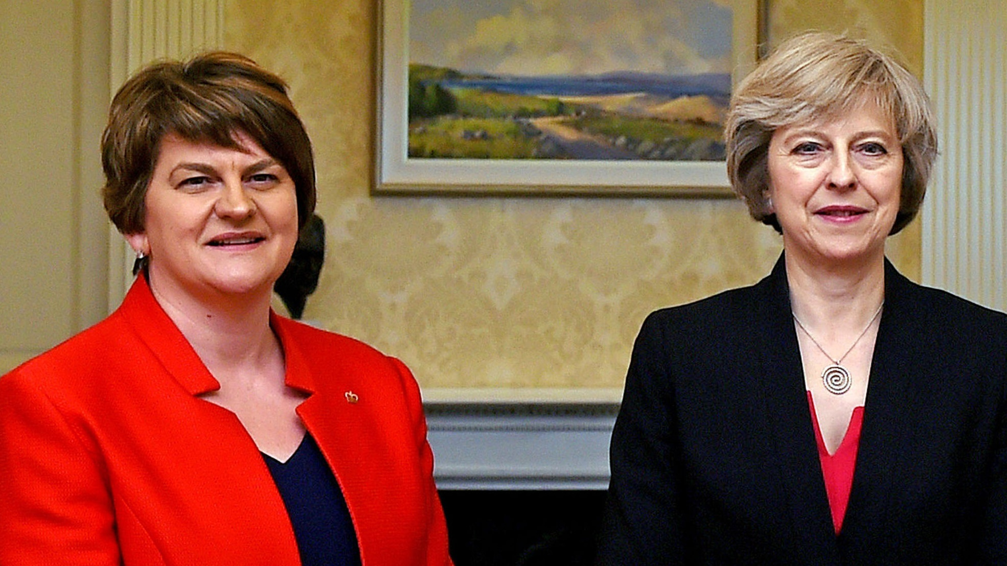 Britains' May to holds talks with DUP to secure deal